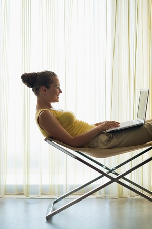 Young woman using laptop at home Stock Photo - 14901622