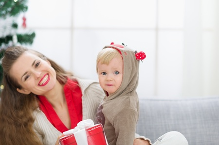 Happy young mother and baby spending Christmas time together Stock Photo - 14917617