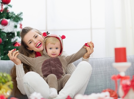 Smiling young mother and baby having fun time on Christmas Stock Photo - 14917648