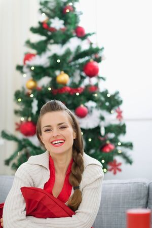 Portrait of smiling young woman near Christmas tree Stock Photo - 14901641
