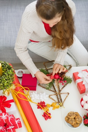xmas crafts: Closeup on table where female making Christmas decorations. Upper view Stock Photo