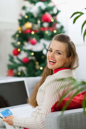 Happy young woman making online Christmas purchases Stock Photo - 14901612