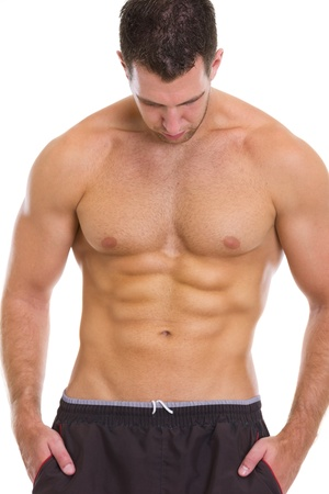 Muscular guy showing abdominal muscles photo