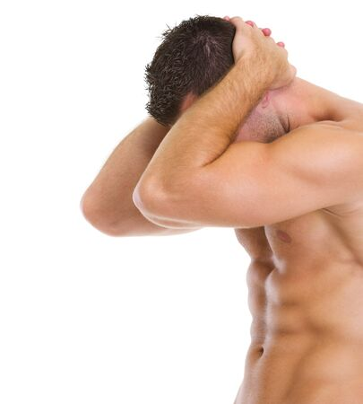 Muscular man showing abdominal muscles photo