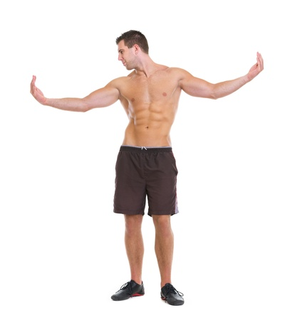 Healthy man showing muscular body photo