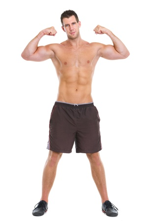 Male athlete showing muscular body photo