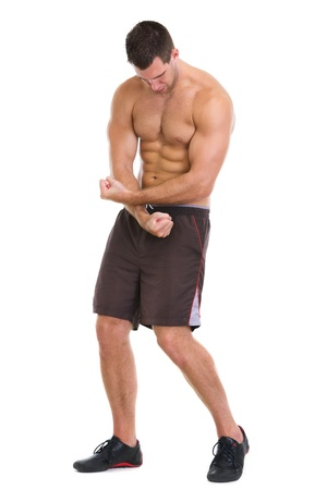 Fitness man showing muscular body photo