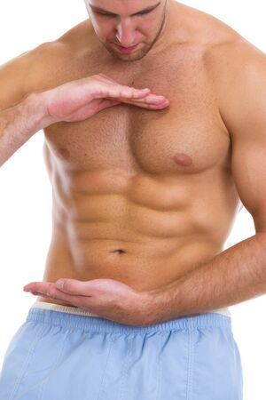 Closeup on male athlete showing great abdominal muscles photo