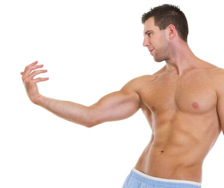 Fitness man with muscular body gracefully posing photo