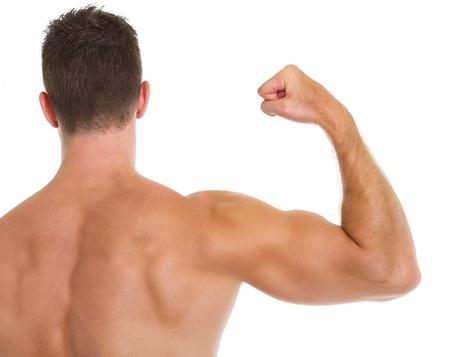Muscular man showing biceps  Rear view photo