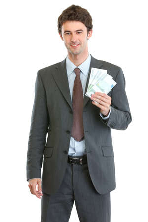 batch of euro: Smiling businessman showing packs of euros