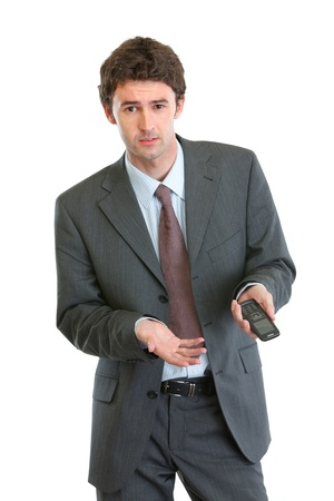 malcontent: Unhappy businessman pointing on mobile phone