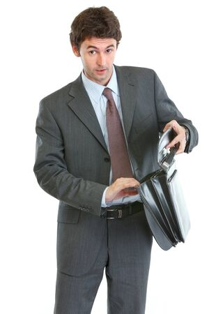 disquieted: Concerned businessman looking into suitcase Stock Photo