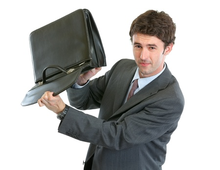 disquieted: Concerned businessman shakes out something from suitcase Stock Photo