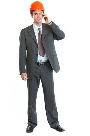Happy architect speaking mobile phone Stock Photo - 14918277