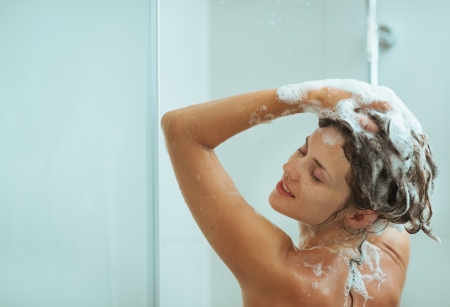 Woman applying shampoo in shower Stock Photo - 14961639