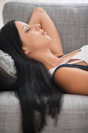 catnap: Young woman sleeping on sofa Stock Photo