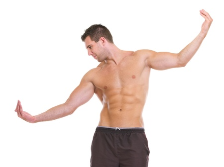 gracefully: Male athlete with muscular body gracefully posing