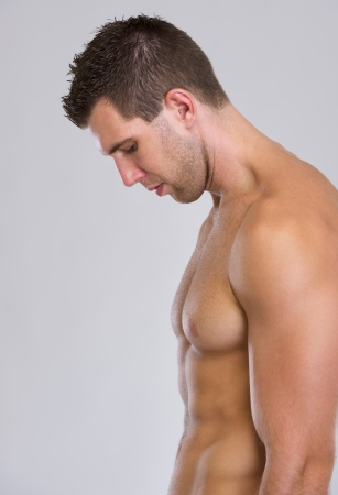 pectoral muscle: Profile portrait of strong muscular man