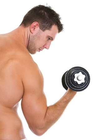 training device: Male athlete with strong biceps rising dumbbell Stock Photo