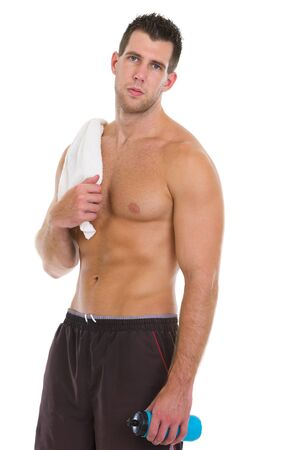 Healthy muscular man with towel and water bottle after workout photo