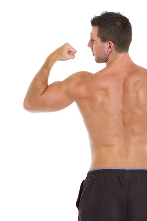 Strong sports man showing biceps  Rear view photo