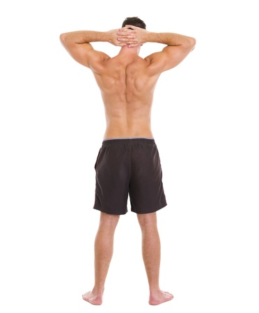 shirtless man: Sports man showing muscular body  Rear view