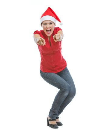 Cheerful young woman in Christmas hat pointing in camera Stock Photo - 15366646