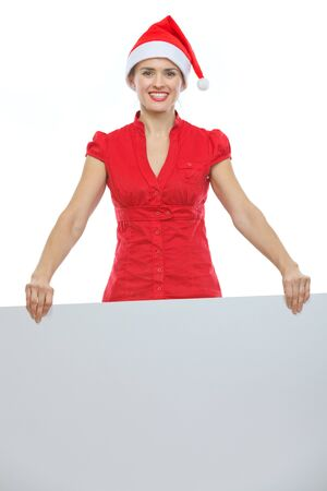 Happy young woman in Christmas hat holding blank billboard Stock Photo - 15366691