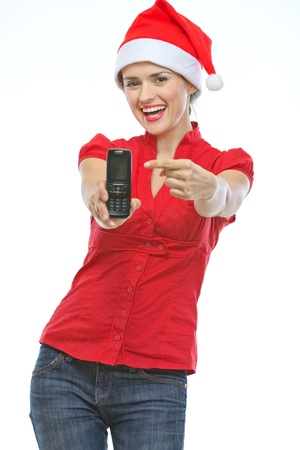 Happy young woman in Christmas hat pointing on mobile phone Stock Photo - 15366704