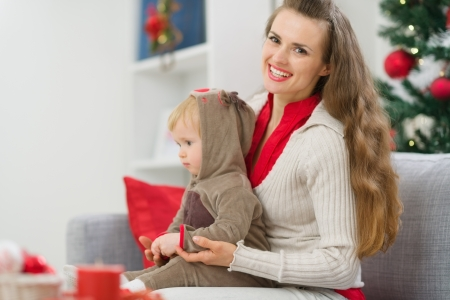 Mother and baby spending Christmas time together Stock Photo - 15366330
