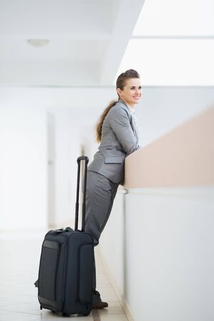 Business woman in business trip with wheel bag Stock Photo - 15652613