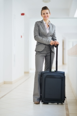 Portrait of business woman in business trip with wheel bag Stock Photo - 15652609