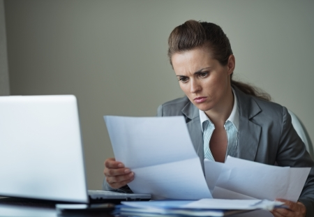 centrality: Business woman working with documents Stock Photo