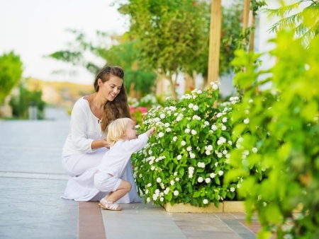 Mother and baby discover vegetable life outdoors Stock Photo - 15652710