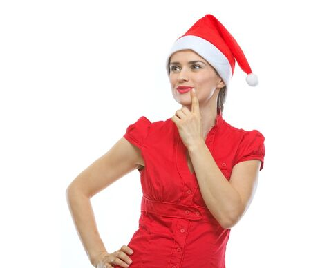 Portrait of thinking young woman in Santa hat looking on copy space Stock Photo - 15762147