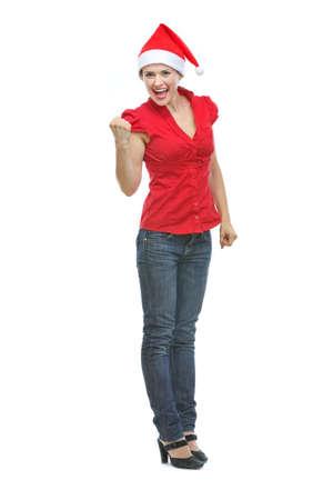 rejoicing: Happy young woman in Santa hat rejoicing success Stock Photo