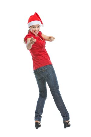 Smiling young woman in Santa hat pointing in camera Stock Photo - 15762135