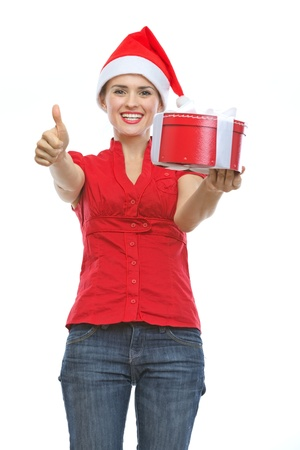 Smiling woman in Santa hat with Christmas present box showing thumbs up Stock Photo - 15762160