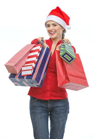 Happy young woman in Santa hat holding shopping bags Stock Photo - 15762173
