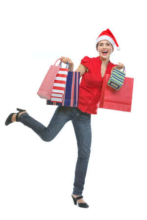 Cheerful young woman in Santa hat holding shopping bags Stock Photo - 15762154