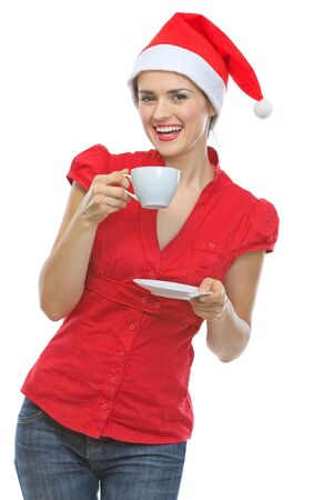Happy young woman in Santa hat drinking hot beverage Stock Photo - 15762168