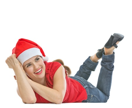 Smiling woman in Santa hat laying on floor and looking on copy space Stock Photo - 15762149