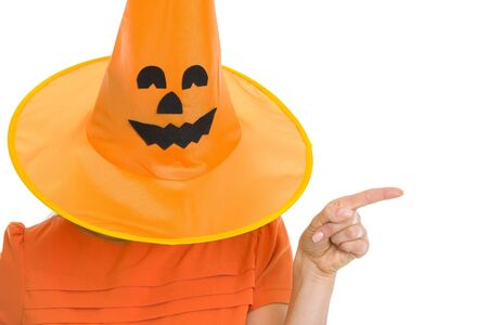 Woman in Halloween hat over head pointing on copy space Stock Photo - 15762206