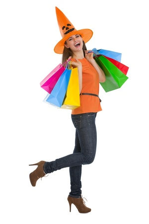 Smiling young woman in Halloween hat with shopping bags Stock Photo - 15762187