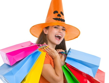 Happy young woman in Halloween hat with shopping bags Stock Photo - 15762198