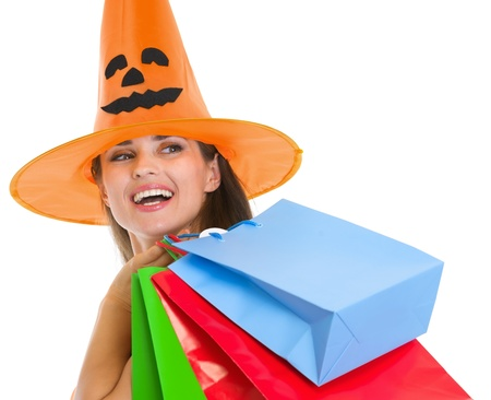 Happy woman in Halloween hat with shopping bags looking on copy space Stock Photo - 15762193