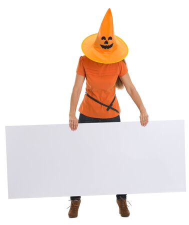 pulled over: Woman with Halloween hat pulled over head holding blank billboard