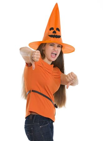 Woman in Halloween hat showing thumbs down Stock Photo - 15786966