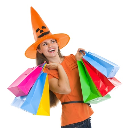 Happy woman in Halloween hat with shopping bags looking on copy space Stock Photo - 15786919